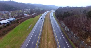 4K Aerial Freeway Pan Down Trucks Transportation Vehicles Driving On Tennessee Road