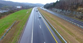 4K Aerial Freeway Pull Back Pan Down Shot Trucks Transportation Vehicles Driving On Tennessee Road