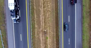 4K Aerial Freeway Top Down Stationary Shot Trucks Transportation Vehicles Driving On Tennessee Road