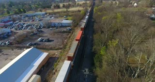 4K Aerial Freight Train Box Cars Flyover Nashville Tennessee Tracks Circle Shot