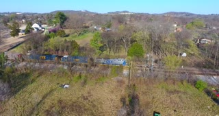 4K Aerial Freight Train Box Cars Flyover Nashville Tennessee Tracks Following Side Circle Shot