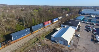 4K Aerial Freight Train Box Cars Flyover Nashville Tennessee Tracks Following Circle Right