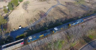 4K Aerial Freight Train Box Cars Flyover Nashville Tennessee Tracks Following Side Tracking Shot