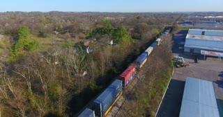 4K Aerial Freight Train Box Cars Flyover Nashville Tennessee Tracks Pull Back Circle Shot