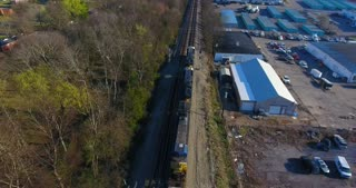 4K Aerial Freight Train Box Cars Flyover Nashville Tennessee Tracks Pull Back Pan Up