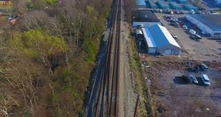 4K Aerial Freight Train Box Cars Flyover Nashville Tennessee Tracks