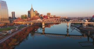 4K Aerial Nashville Tennessee Bridge Fly Under Skyline City Traffic Freeway Urban Roads Buildings