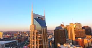 4K Aerial Nashville Tennessee Bridge Fly Under Skyline City Traffic Urban Roads Buildings Circle Shot Building