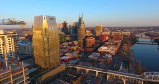4K Aerial Nashville Tennessee Bridge Fly Under Skyline City Traffic Urban Roads Buildings Constriction Building Circle Shot