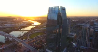 4K Aerial Nashville Tennessee Bridge Fly Under Skyline City Traffic Urban Roads Buildings Cable Cam Right