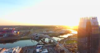 4K Aerial Nashville Tennessee Bridge Fly Under Skyline City Traffic Urban Roads Buildings