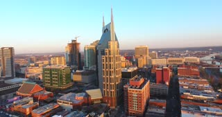 4K Aerial Nashville Tennessee Bridge Fly Under Skyline City Traffic Urban Roads Buildings AT&T Building Circle Shot