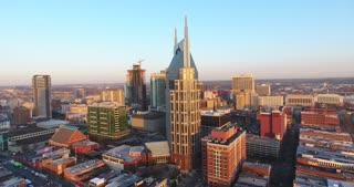 4K Aerial Nashville Tennessee Bridge Fly Under Skyline City Traffic Urban Roads Buildings Circle Shot At&T Building