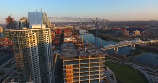 4K Aerial Nashville Tennessee Constriction Building Circle Shot Bridge Fly Under Skyline City Traffic Urban Roads Buildings