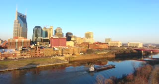 4K Aerial Nashville Tennessee Skyline Tug Boat Barge Tracking Shot City Urban Roads Buildings