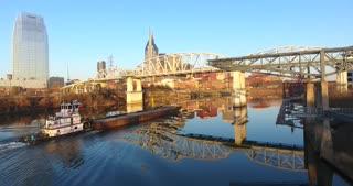 4K Aerial Nashville Tennessee Skyline Tug Boat Going Under Bridge City Urban Roads Buildings