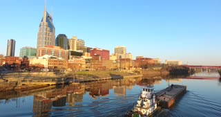 4K Aerial Nashville Tennessee Skyline Tug Boat Rising Jib Shot City Urban Roads Buildings
