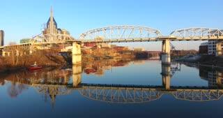 4K Aerial Nashville Tennessee Skyline Walking Bridge Jib Shot Rising City Urban Roads Buildings