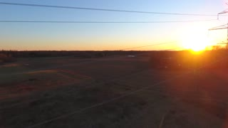 4K Aerial Power Lines High Voltage Sunset Pan Right Shot