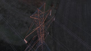 4K Aerial Power Lines High Voltage Sunset Pull Back Shot
