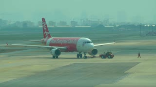 4K Air Asia Airline Pulling Out Onto Tarmac Terminal Transportation World Airplane Travel Thailand Bangkok Airport