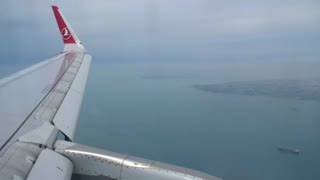 4K Airplane Wing Flying Through Clouds Passanger Cabin Airport Airline Jet Plane Flight Turkish Air Istanbul Harbor