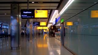 4K Airport Terminal Jib Shot London Hethrow Marker A 19 Departures Slider Shot Termanal Airport Airline Jet Plane