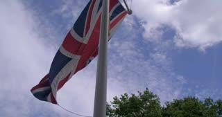 4K British Flags Leading Into Buckingham Palace London England Capital Slider Shot