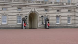 4K British Guards Standing Watch At Buckingham Pallace In London