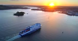 4K Brittany Ferries Sunset Arriving In Plymouth England Aerial Flyover Docking Ferry Ship Boat Ocean Islands