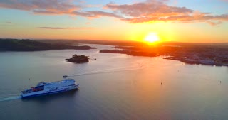 4K Brittany Ferries Sunset Arriving In Plymouth England Aerial Tracking Shot Docking Ferry Ship Boat Ocean Islands