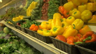 4K Fall Harvest Bell Peppers Cucumbers Squash Market Fresh Grocery Store Produce Slider Shot