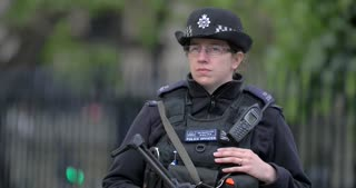 4K Female Security Officer With Rifle London Terror Attack Slow Mo