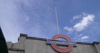 4K London Underground Metro System Embankment Station Pan Down People Surging Out Public Transit