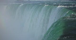 4 K Niagria Falls Mist Cloud Waterfall Water Flowing Over Edge Tight Shot Pan Down