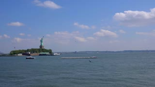 4K NYC Statue Of Liberty Pan Left Helicopters Tug Boat Flag Freedom Urban Park New York City