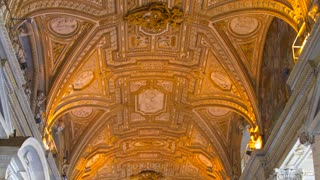 4K Saint Peters Basilica In Rome Pan Down Ornate Hallway