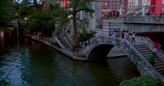 4K San Antonio River Walk Pan Up To The Torch Of Friendship San Antonio Gimbal Shot City Texas Flag Traffic Intersection La Antorcha De La Amistad