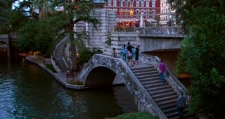 4K San Antonio River Walk Tourists Pan Left Reveal City Texas Flag Traffic