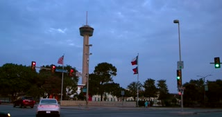 4K San Antonio Slider Shot Reveal Tower Of The Americas City Wide Shot Texas Flag Traffic Intersection