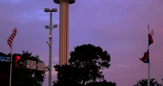 4K San Antonio Sunset Tower Of The Americas Pan Up City Tight Shot Texas Flag