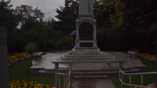 4K Slider Angel Moroni On Hill Of Cumorah Mormon Monument Wide Shot New York Tourists Pan Up