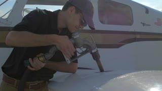 4K Slider Shot Airplane Pilot Pumping Gass Fuel Tank Nozzle