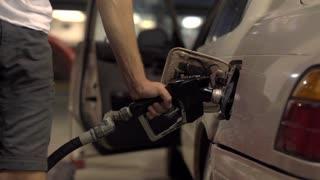4K Slider Shot Pumping Gass Into Car Fuel Pump