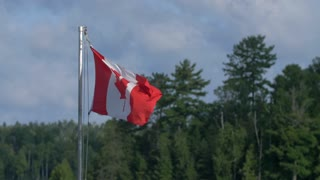 4K Slow Mo Canadan Flag Wilderness Flapping In The Breeze