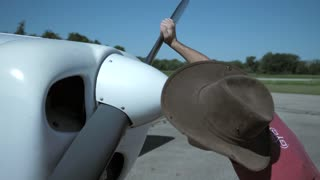 4K Slow Mo Piliot Pre Flight Checking Propellor Flying Small Airplane Beachcraft Musketeer Airport