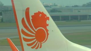 4K Thai Lion Logo Tail Airline Pulling Landing Tracking Shot Runway Tarmac Terminal Transportation World Airplane Travel Thailand Bangkok Airport