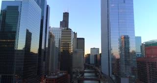 Aerial Chicago Illinois Cinematic Conclusion Shot Pull Back Train Skyscrapers Urban City Drone