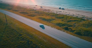 Aerial Classic Car Golden Hour Romantic Beach Drive Sunset Drone Shot 1940 Plymouth 4K