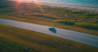 Aerial Classic Car Sun Flares Golden Hour Romantic Beach Drive Sunset Drone Shot 1940 Plymouth 4K